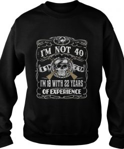 Skull and guns I'm not 40 I'm 18 with 22 years of experience 1979 sweater